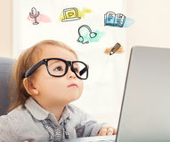 E Learning concept with toddler girl. Using her laptop Royalty Free Stock Photo
