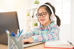 E-learning give preschool kids perfect study. Resource. asia cute sweet children typing with computer keyboard and listen headsets stock image