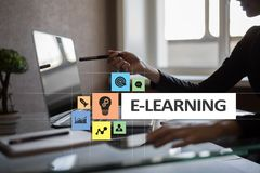 E-Learning on the virtual screen. Internet education concept. royalty free stock photo