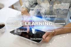 E-Learning on the virtual screen. Internet education concept. Stock Photos