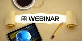 E-Learning webinar Online Learning Online course. Paper work with webinar e-Learning Online Learning Online course, tablet, pencil and a cup of coffee stock photo