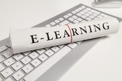 E-learning. Written on newspaper Stock Photos
