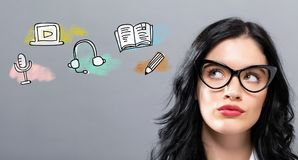E-Learning with young businesswoman. In a thoughtful face Royalty Free Stock Photo
