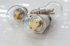 E27 LED bulbs with different light-emitting chips in transparent Stock Photos