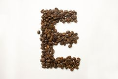 E the letter. alphabet of coffee. Coffee beans. concept of healthy eating. photo for your design. horizontal orientation of the sheet stock photo