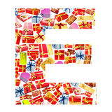E Letter  made of giftboxes Stock Image
