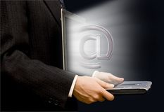 E-mail connection. Businessman with an open laptop and e-mail symbol coming out of the screen Royalty Free Stock Image