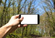 e - mail cyfrowego formatu ręce gospodarstwa komórki wysyłającego Zdjęcia Stock