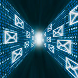 E-mail icons flying along walls of binary code Stock Images