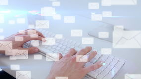 An E-mail interface over hands typing stock footage