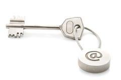 E-mail key. Key with e-mail symbol isolated over white Stock Image