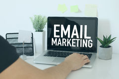 E-mail marketing business concept with businessman in office Stock Photography