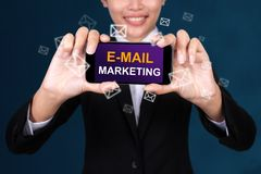 E-MAIL MARKETING concept, Happy businesswoman Show text e-mail m royalty free stock photo