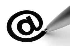 E-Mail Sign. With tip of pen, on white Stock Image