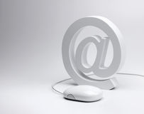 E-mail @ sign and computer mouse Royalty Free Stock Photography