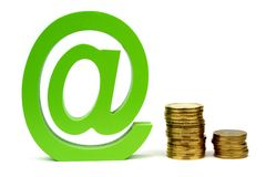 E-mail sign and stacket coins Royalty Free Stock Photography