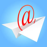 E-mail symbol. E-mail symbol flying on paper plane against the blue sky Royalty Free Stock Images