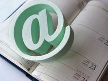E-mail symbol. An @ symbol standing on the calendar royalty free stock image
