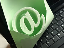 E-mail symbol. An @ symbol in the envelope standing on the keyboard royalty free stock photos