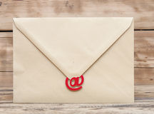 E-mail symbol and blank brown envelope Royalty Free Stock Photo