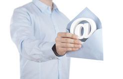 E-mail symbol with envelope in hand Stock Images