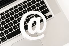 E-mail symbol on a laptop computer keyboard concept for email, communication or contact us stock photos