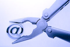 @ - e-mail symbol & pliers Stock Photos