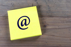 E mail symbol on post it note. Royalty Free Stock Image