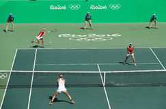 E. Makarova of Russia, T. Bacsinszky and M. Hingis of Switzerland (in red)  during women's doubles final Royalty Free Stock Photography
