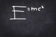 E=mc2 formula on chalkboard. Education handwritten on chalkboard background Stock Photo
