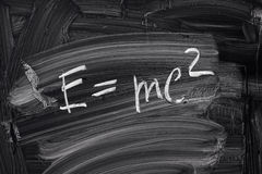 E=mc2. Theory of relativity, writings on blackboard Royalty Free Stock Image