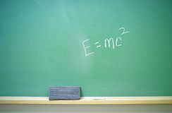 E=mc2 equation 2. A horizontal green chalkboard with Albert Einstein's E=mc2 equation. 14MP camera Stock Image