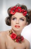 E Mujer joven con maquillaje Foto de archivo