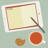 E-nota e tazza di tè Immagine Stock