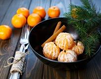 E Os mandarino das citrinas na placa imagem de stock royalty free