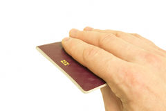 E-Passport. A hand holding an e-passport, isolated on white Stock Photos