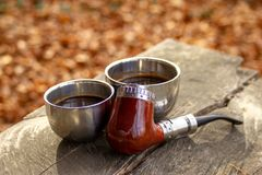 E-pipe with blurred background and cup of coffee in natural ambient stock images