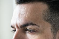 Side portrait of white man closeup on eyes stock photography