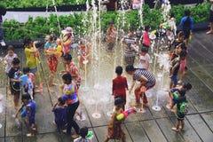 Bangkok, Thailand - April 15, 2019 : Songkran festival or Thai New Year`s festival, Asian Kid Playing water and fountain at