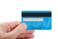 拿着信用卡的手被隔绝在白色背景 免版税图库摄影