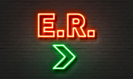 E. R. neon sign on brick wall background. Stock Photos