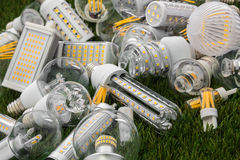 E27, R7s and G4 ecological and economical LED bulbs. Big family of ecological and economical LED bulbs of various types on the green grass Royalty Free Stock Photo
