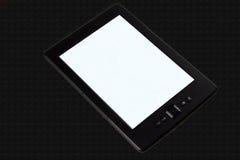 E-reader. On black texture background Royalty Free Stock Photos