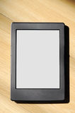 E-Reader. Electronic book reader on wood background Stock Photography