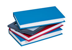 E-reader in a stack of books. Stock Photo