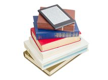 E-reader on a stack of ordinary paper books royalty free stock photography