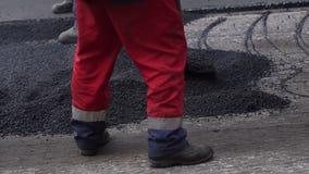E Reparaci?n de caminos asfalto almacen de metraje de vídeo