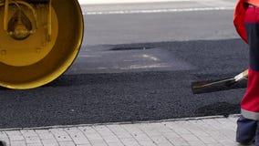 E Reparaci?n de caminos asfalto almacen de video