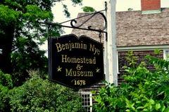 E. Sandwich, MA: Benjamin Nye Homestead Sign. East Sandwich, Massachusetts - Jul 15, 2015:  Signpost at the historic 1678 Benjamin Nye Homestead and Museum on Royalty Free Stock Photos