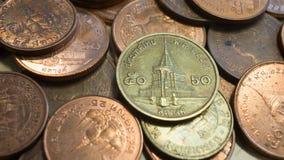 50 e 25 Satang0 tailandesi delle monete, 5 e 0 Baht 25 Fotografie Stock